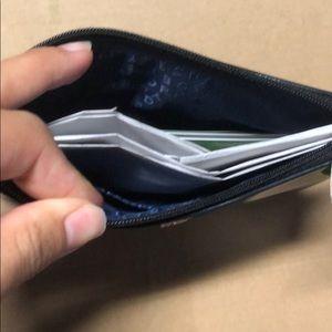 kate spade Bags - slg mini pouch (glitter blue)